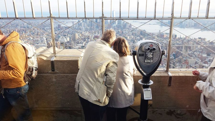 People At Observation Point Against Empire State Building In City