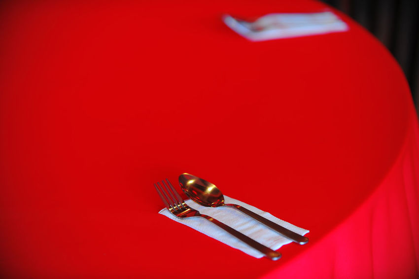 spoon and fork on red table for Chinese New Year Decoration. Banquet Celebration Chinese Food Fork Romantic Spoon Tissue Travel Backgrounds Chinese Chinese Culture Culture Decoration Festival Forks Kitchen Oriental Party Red Restaurant Serving Food And Drinks Symbol Table Tablecloth Tourism