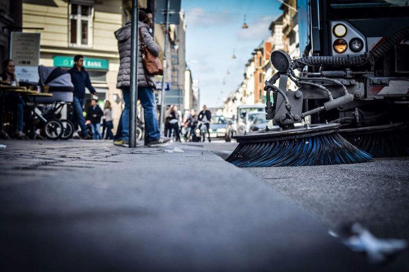 Street sweeper in city