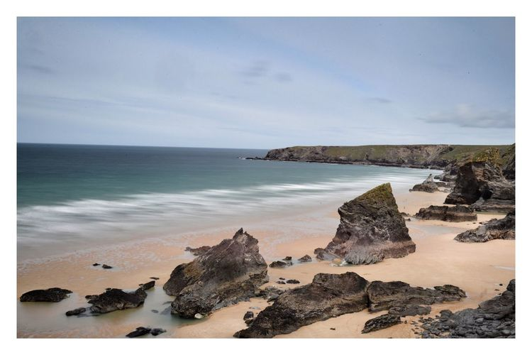 Bedruthan Steps in cornwall England Cornwall Cornwall Beach Bedruthan Steps Sea Water Land Beach Rock Sky Rock - Object Horizon Over Water Solid Horizon Beauty In Nature Nature Tranquility Scenics - Nature Sand Auto Post Production Filter Cloud - Sky Tranquil Scene Rock Formation No People