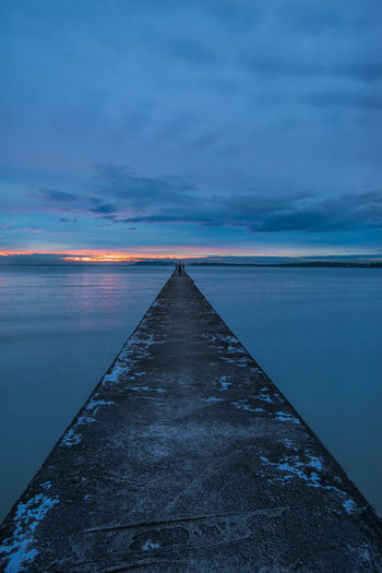 Long jetty with long exposure. Beauty In Nature Blue Calm Cloud - Sky Diminishing Perspective Dramatic Sky Dusk Horizon Over Water Idyllic Long Moody Sky Nature Non-urban Scene Ocean Pier Scenics Sea Seascape Sky Surface Level The Way Forward Tourism Tranquil Scene Tranquility Water