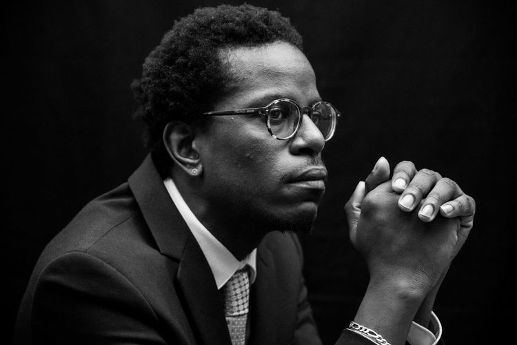 Headshot One Person Portrait Young Men Studio Shot Indoors  Looking Away Men Glasses Eyeglasses  Black Background Young Adult Males  Looking Front View Adult Lifestyles Close-up Hand Contemplation Hairstyle Blackandwhite