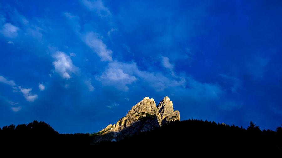 Amazing magic light phenomena where the last rays of light raises upon the italian dolomites.