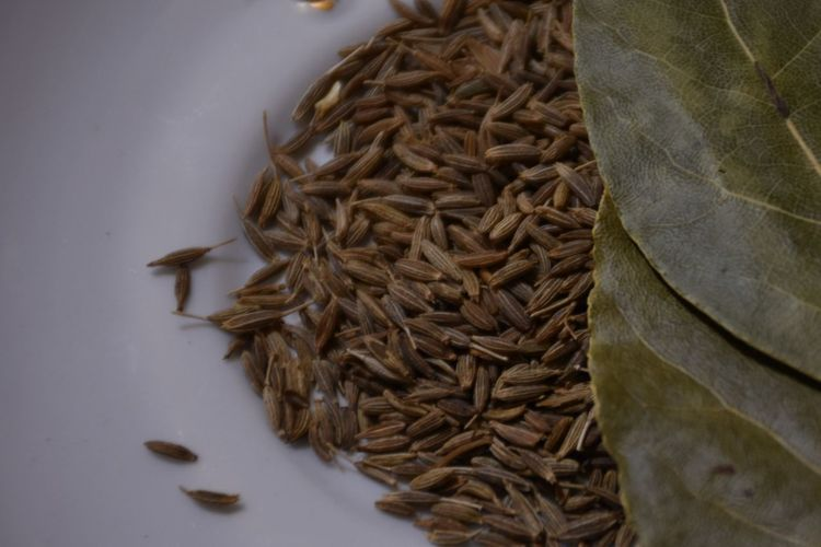 Cumin seeds (Jeera) and Bay Leaves - perfect colors and taste combination. Bay Bay Leaves Brown Brown Shades Clean Image Close-up Cumin Food Food And Drink Food Stories High Angle View Jeera No People Spice Spices Spices And Herbs Spices Collection Zira