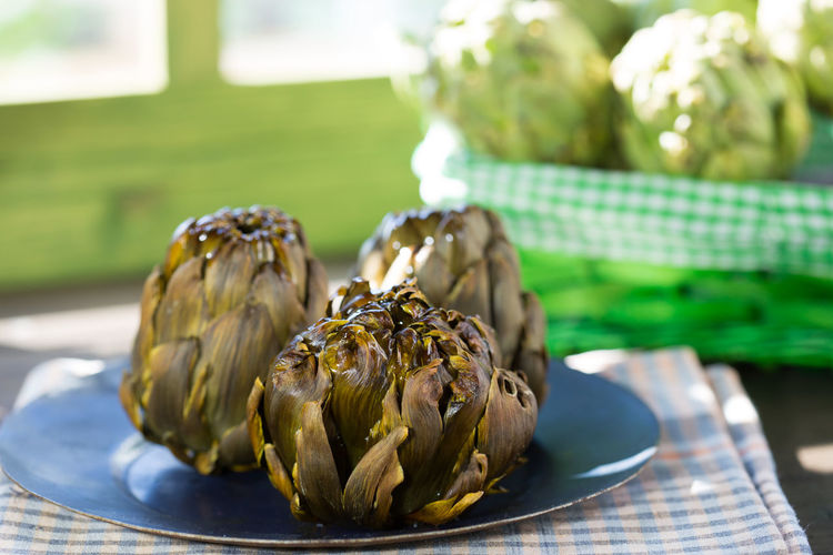 Close-up of artichokes in plate on table