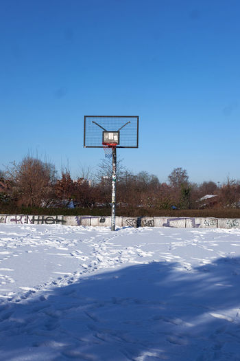 View of basketball hoop on field against sky