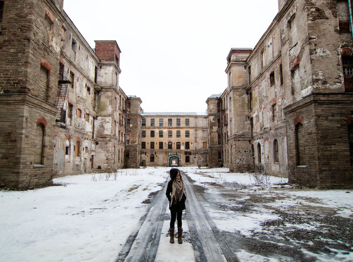 Narva, Kreenholm factory Abandoned Abandoned & Derelict Abandoned Buildings Abandoned Places Architecture Architecture Architecturelovers Building Exterior Built Structure Cold Temperature Industrial Lifestyles One Person Outdoors Person Sky Snow Standing Symmetry Warm Clothing Winter
