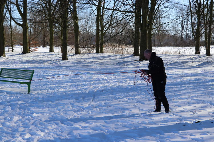 Man on snow covered field
