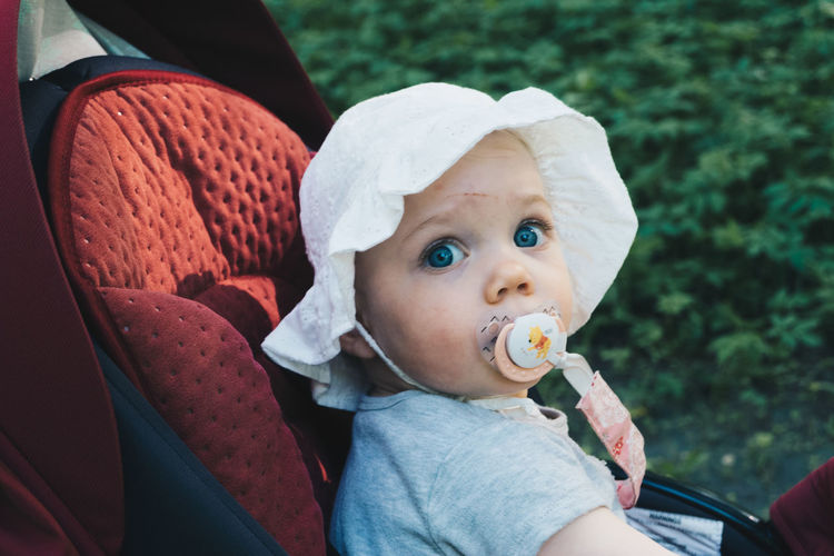Portrait Of Cute Baby Girl Siting In Stroller