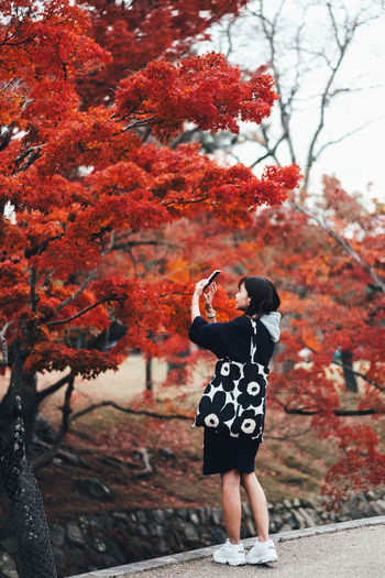 love photo One Person Tree Plant Full Length Real People Leisure Activity Lifestyles Nature Day Casual Clothing Women Red Focus On Foreground Autumn Standing Growth Rear View Young Adult Change Outdoors Human Arm Arms Raised Red Red Color Autumn colors 2018 In One Photograph