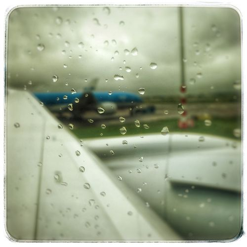 It was a rainy day at Amsterdam last Monday, August 22nd 2016 Schipolairport KLM Airport Airplane Window Water Airplane Wing Airplane Window Airplane View Airplaneview Sky And Clouds Traveling Hello World Travel Photography Clouds Rainy Days Rain Airportphotography Airport Runway Airport Photography Airport Clouds Airport Schipol