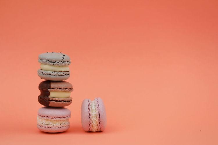 Studio shot of cookies against orange background