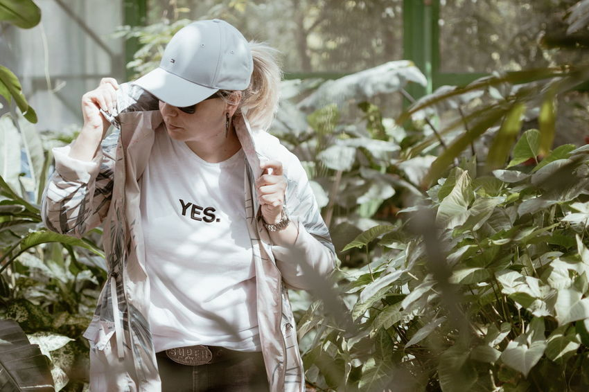 Casual Clothing Day Front View Growth Hat Holding Innocence Leisure Activity Lifestyles Nature One Person Plant Real People Standing Waist Up Women
