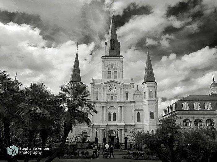 Facade of church against cloudy sky