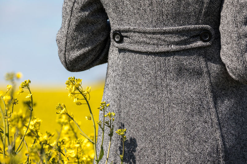 Beauty In Nature Close-up Coat Day Field Flower Freshness Growth Jacket Nature Oilseed Rape One Person One Woman Only Outdoors People Plant Real People Rear View Rural Scene Sky Yellow Yellow Color Yellow Flower