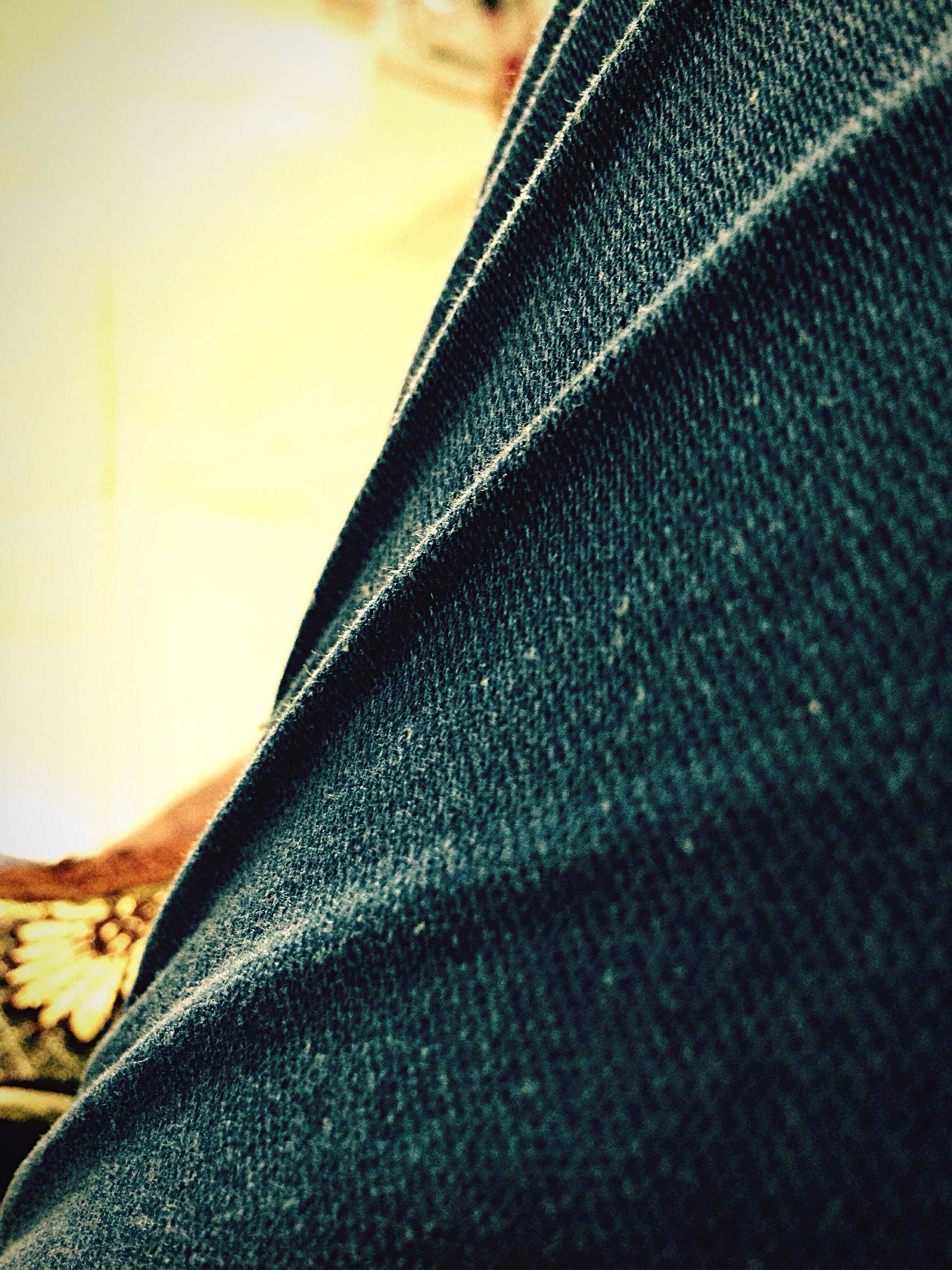 close-up, indoors, person, jeans, casual clothing, focus on foreground, personal perspective, limb