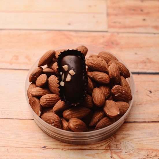 Almond London with almond nut Wooden Background Cookies Almondlondon Food And Drink Food Freshness Still Life Table Nut Indoors  Wellbeing Wood - Material Healthy Eating Almond Focus On Foreground Nut - Food Close-up Bowl Brown High Angle View No People Large Group Of Objects Sweet Food