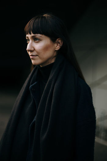 Brunette woman wearing a black coat