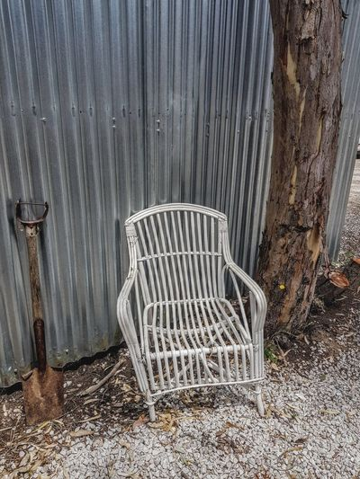 Australian country Cane Chair Old Shovel GumTree Gardening Old Shed Tin Corrigated Tin No People Day Chair Architecture Outdoors Built Structure