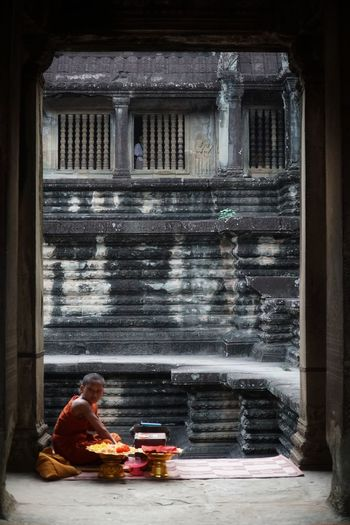 Monk sitting at old ruin temple