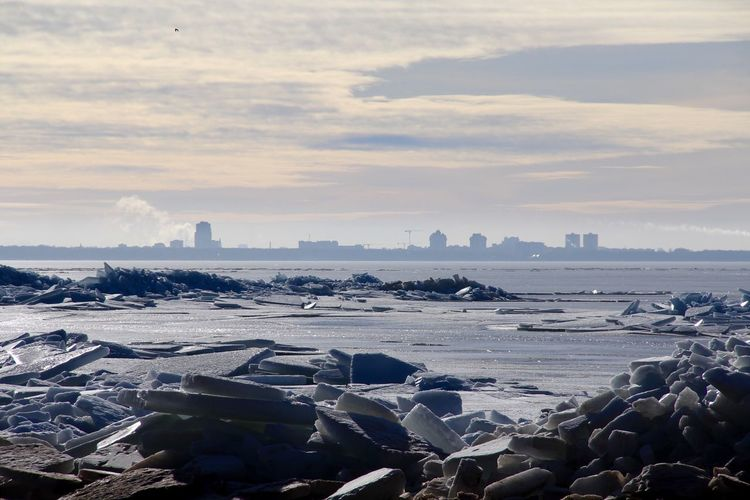 Ice floating on baltic sea against cloudy sky