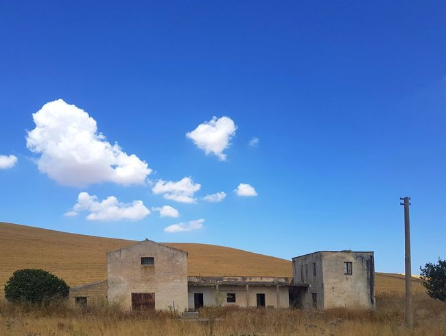 Travel Photography Streetphotography Visititaly Siciliabedda Scenic Landscapes Landscape_Collection Arid Landscape Countryside Rural Rural Scene Landscape Farmland Blue Desert Sand Dune House Sky Architecture Building Exterior Built Structure Cloud - Sky Detached House Abandoned Damaged Ruined