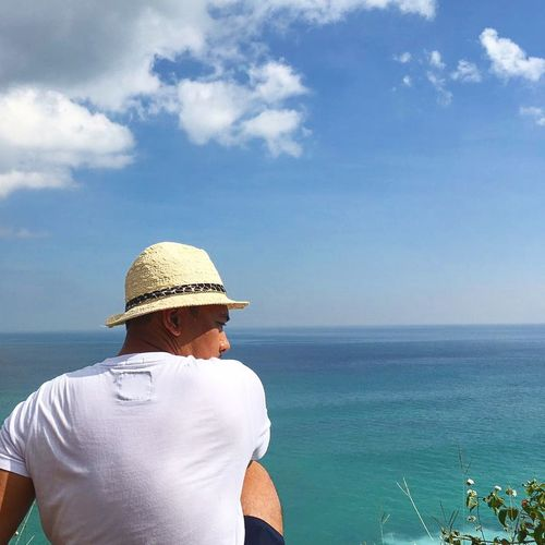 Horizon Over Water Lifestyles People Sun Hat Sea Beach Hat Water Summer Vacations Rear View Day Leisure Activity Sky Outdoors Nature