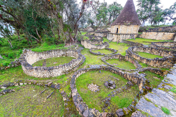 Ancient ruins of round houses in the city of Kuelap, Peru Amazonas Ancient Archeology Architecture Building Chachapoyas Chachapoyya City Culture Fortress Green Kuelap Old Ruin Ruins South America Stone Tourism Travel Travel Destinations Utcubamba