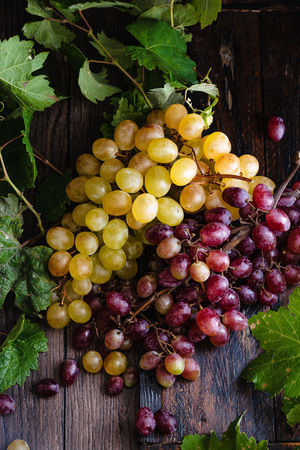 bunches of white and red grapes on a rustic base Autumn Dessert Freshness Vegetarian White Grape Bunch Close-up Fall Food Freshness Fruit Grape Healthy Eating Ingredient Juicy Fruit Leaf Nature No People Organic Plant Part Purple Ripe Seasonal Sweet Wellbeing