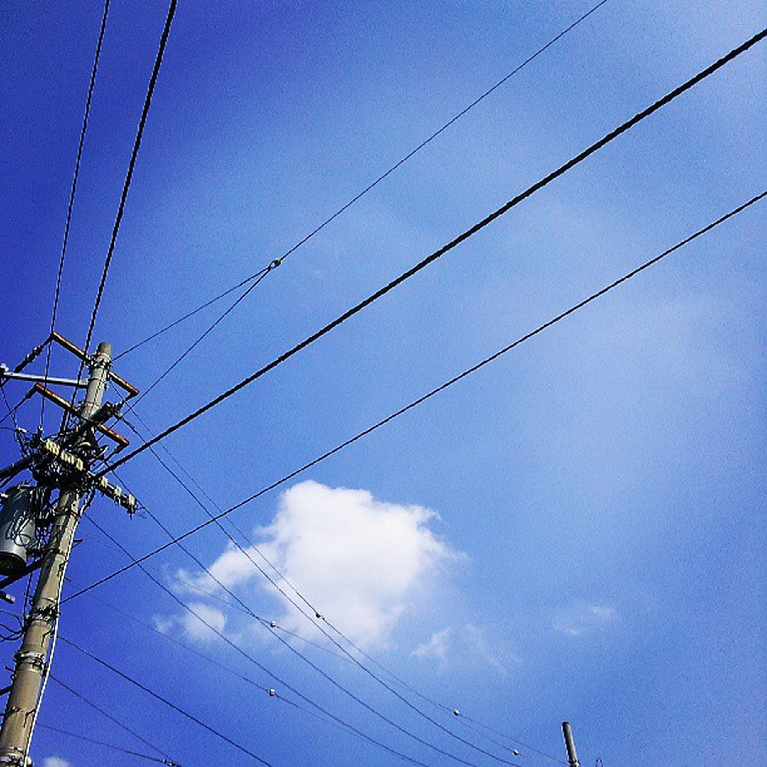 power line, low angle view, cable, electricity, power supply, connection, electricity pylon, sky, fuel and power generation, technology, power cable, blue, wire, silhouette, pole, cloud, complexity, cloud - sky, outdoors, no people