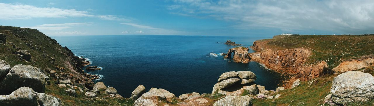 Stone Material Blue Sky Beauty In Nature Horizon Over Water Water Sea Cliff Non-urban Scene Panoramic Rock Formation Idyllic Tourism Geology Travel Destinations Seascape Nature Rock - Object Tranquility Scenics Tranquil Scene Cornwall LandsEnd