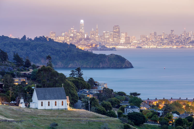 Scenic views of Old St Hillary's Church, Angel Island, Alcatraz Prison, San Francisco Bay and San Francisco Skyline at dusk. Shot from Tiburon, Marin County, California, USA. Old St Hillary's Church Bay Area San Francico Tiburon  Bay Skyscraper Office Building Exterior High Angle View Scenics - Nature Outdoors Cityscape Beauty In Nature Residential District Land No People Tree Sky Nature Sea City Building Water Building Exterior Built Structure Architecture Waterfront Skyline Downtown Angel Island Alcatraz Island Alcatraz Prison Church Twilight Dusk Travel Tourism Landscape Urban Marin County California Skyscreaper Tower Scenics View Scenery Landmark View From Above Peninsula Park Old St. Hilary's Open Space Preserve