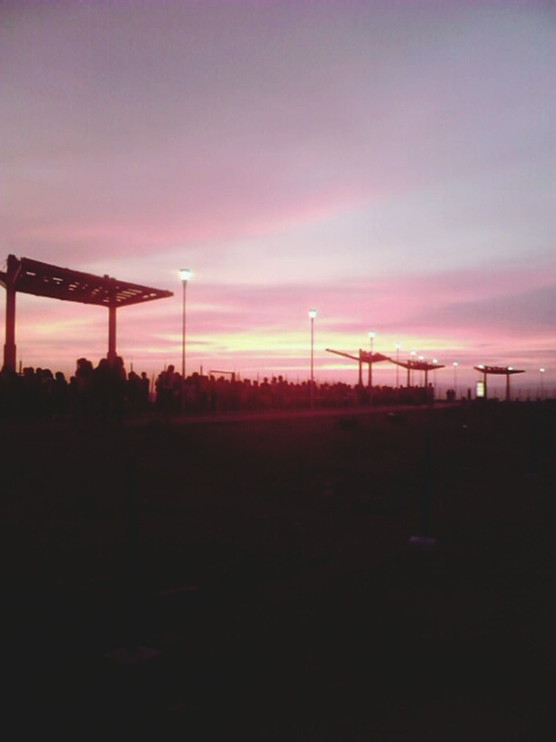 sunset, silhouette, sky, orange color, tranquility, scenics, tranquil scene, landscape, beauty in nature, nature, dark, dusk, cloud - sky, connection, electricity pylon, idyllic, dramatic sky, no people, outdoors, copy space