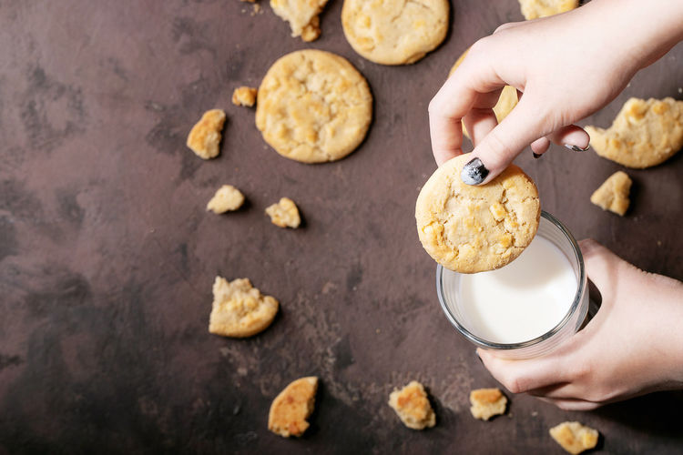High angle view of person preparing cookies on table