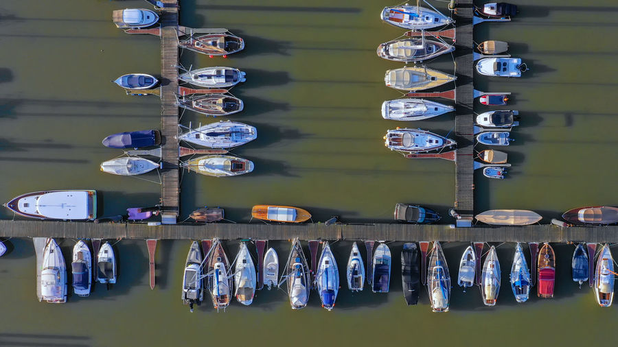 Aerial view of sailboats at harbor