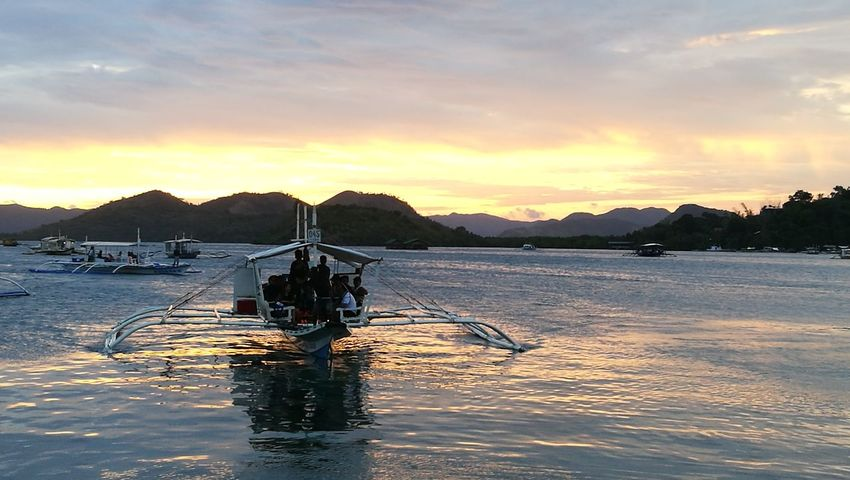 Sunset in Coron #coronpalawan Palawan Philippines #vacation #metime  Sunset Water Sky Sea Nature Outdoors Beach Scenics Nautical Vessel Tranquility Mountain Beauty In Nature