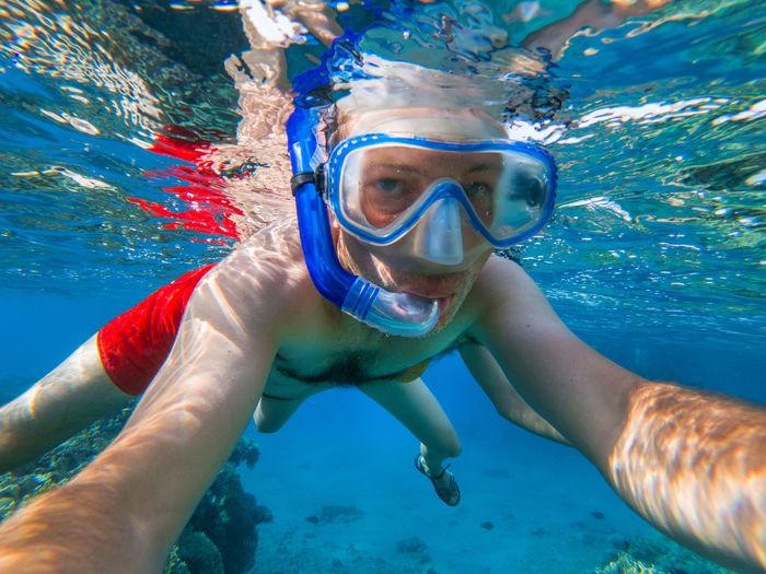 Portrait of man snorkeling in sea