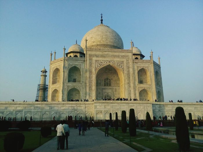 Indian sites Taj Mahal In The Evening Aagra Trees Grass Sky Blue With Eyeem