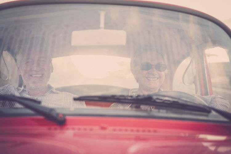 Cheerful Senior Couple Traveling In Car