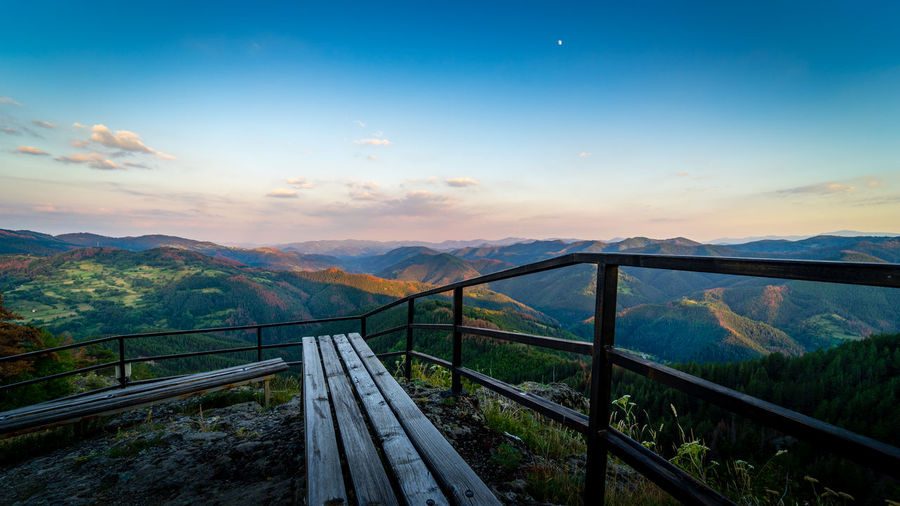A bench offers a spectacular view over the soft forms of the Rhodope mountains in the south of Bulgaria, gilded by the last rays of the summer sun Bench Blue Hour Bułgaria Rhodopes High Angle View Landscape Mountain Mountain Range Nature No People Outdoors Railing Scenics Sky Summer Tranquil Scene
