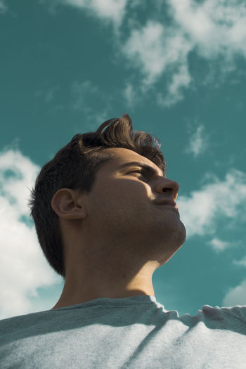 Boys Cloud - Sky Contemplation Day Focus On Foreground Headshot Leisure Activity Lifestyles Looking Low Angle View Men Nature One Person Outdoors Photography Popular Photos Portrait Profile View Real People Side View Sky Teenage Boys Teenager Young Adult Young Men The Portraitist - 2018 EyeEm Awards 50 Ways Of Seeing: Gratitude This Is Natural Beauty