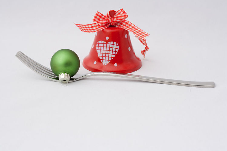 Still Life Indoors  Studio Shot White Background Copy Space Close-up Kitchen Utensil Fork Christmas Christmas Decoration Christmas Ornament Holiday Celebration Merry Christmas! Restaraunt Catering Eating Food And Drink Backgrounds Christmas Decorations Holidays Holiday - Event Bell Ball