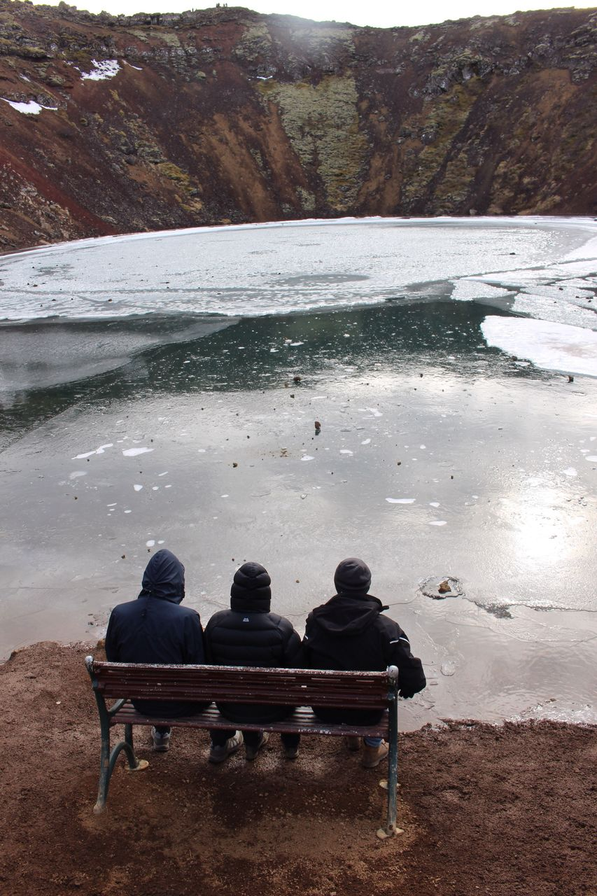 sitting, men, nature, day, tranquility, rear view, real people, tranquil scene, outdoors, scenics, beauty in nature, water, winter, relaxation, togetherness, landscape, people