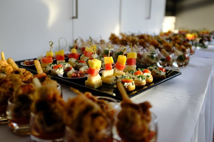Close-up of snacks on tables