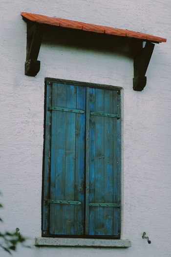 Low Angle View Of Closed House Window