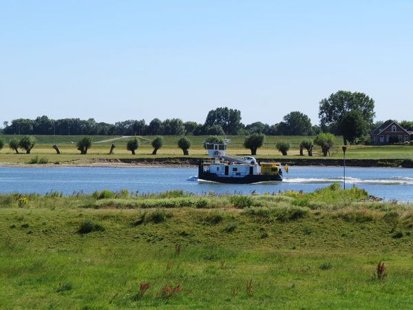 half a boat Water Vaartuig Nature Canals And Waterways Canal Boat Vessel Rijn Tugboat Agriculture Nautical Vessel Lake Field Sky Floating On Water