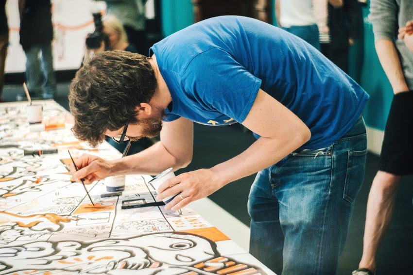 Artist's focus Real People Concentration One Person Artist Indoors  Adult Drawing Painting Painter Art Is Everywhere Arts Culture And Entertainment ArtWork Focus Focused Man Young Men Young Adult Detail Working Working Hard Installation Art Modern Art Bearded Paintbrush Painting Art
