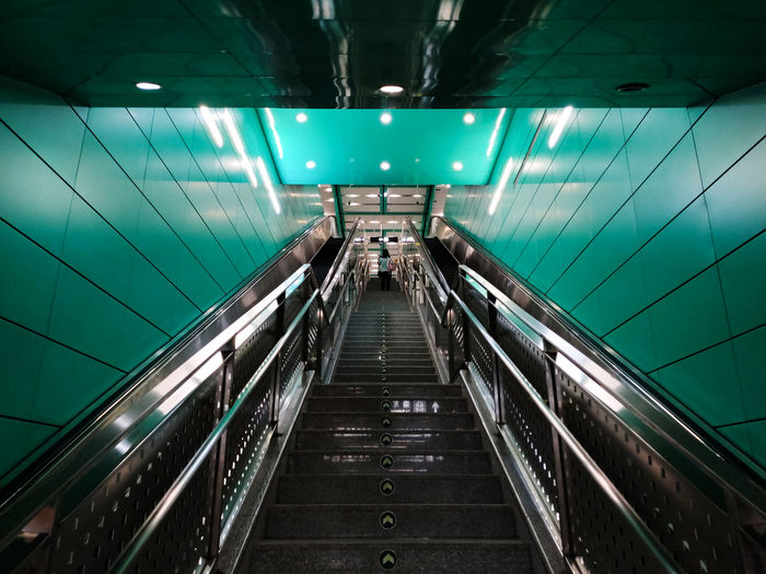 Low angle view of escalator in subway