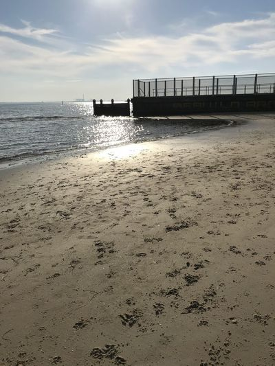 Late day sun over an old pier at St Kilda Beach. Victoria. Australia. Beach Water Sea Sky Land Sand Nature Built Structure Scenics - Nature Beauty In Nature Cloud - Sky Architecture No People Tranquility Horizon Over Water Tranquil Scene Pier Horizon Outdoors Australia St Kilda Beach