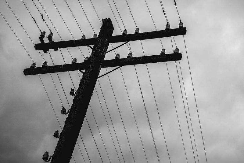 Sky Low Angle View Cloud - Sky Cable Nature Connection No People Day Transportation Mode Of Transportation Outdoors Silhouette Built Structure Architecture Dusk Overcast Construction Industry Mast Pole Metal Sailboat Power Supply